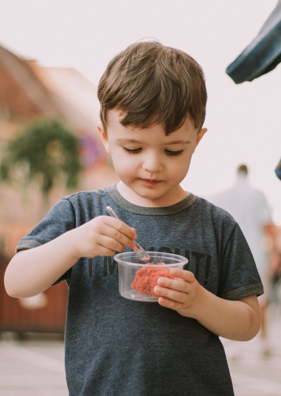 Little boy eating organic food